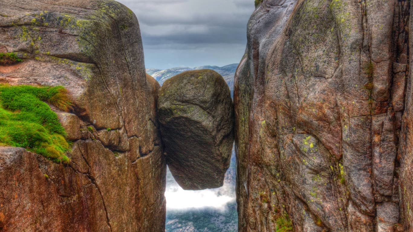 The Kjeragbolten boulder on Kjerag, a mountain in Rogaland, Norway (© Nataliia Anisimova/Alamy) 234