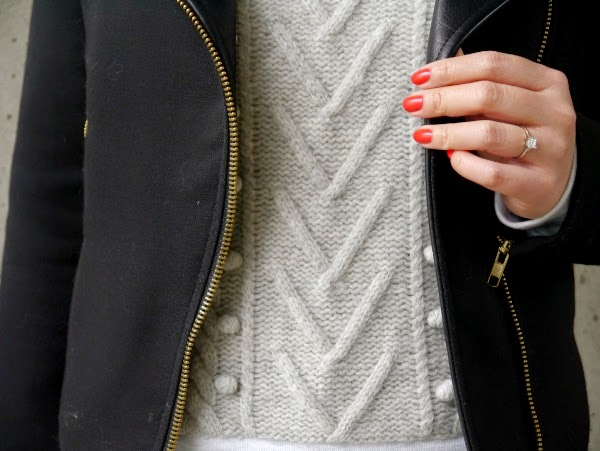 Coral nails, moto jacket and cable knit pom pom sweatshirt
