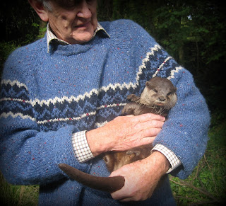 Martin Neville with Belinda the Otter ~ photo: Daphne Neville
