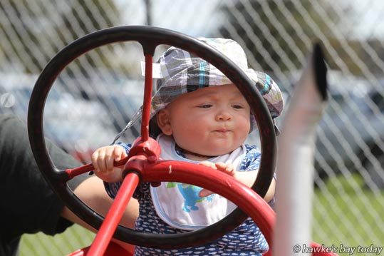 George Lindstrom, 8 months, Hastings, on a tractor. photograph