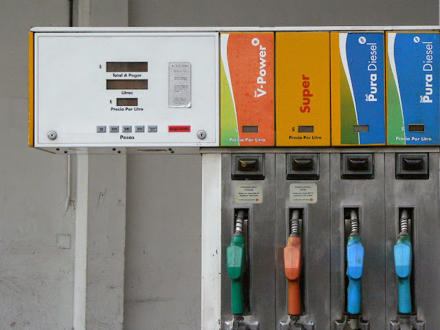 Close up photograph of a gas pump with prices in pesos and labels in Spanish