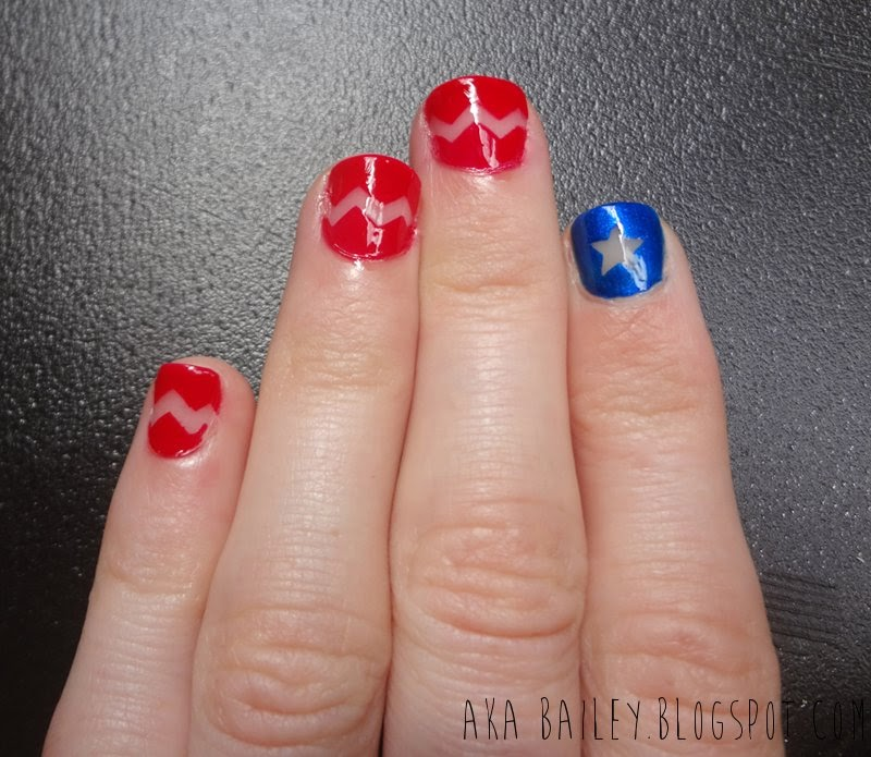 Red chevrons, negative space, blue star, 4th of July nails