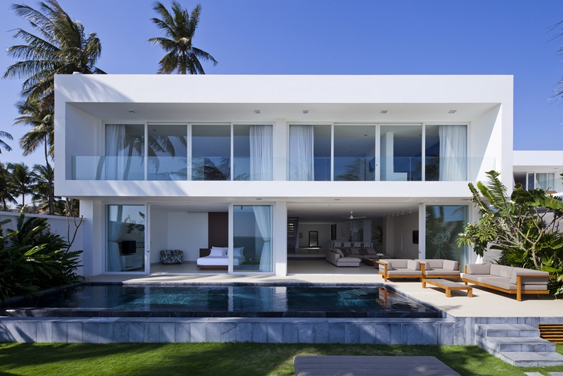 Terrace and swimming pool of modern beach house