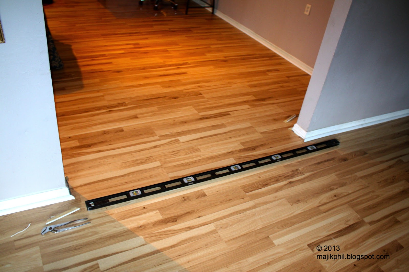 Laminate flooring put laminate flooring around fireplace for Floating laminate floor