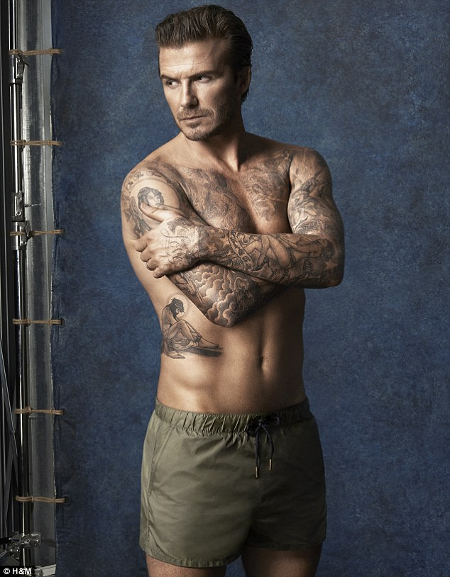 David Beckham in his pants showing off his tattoos
