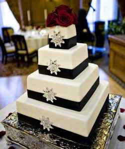 Square Wedding Cake Decorated with Black Ribbon