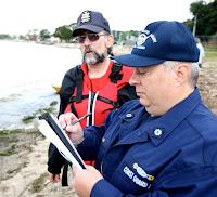 Auxiliarist Bob Daraio and Kayaker