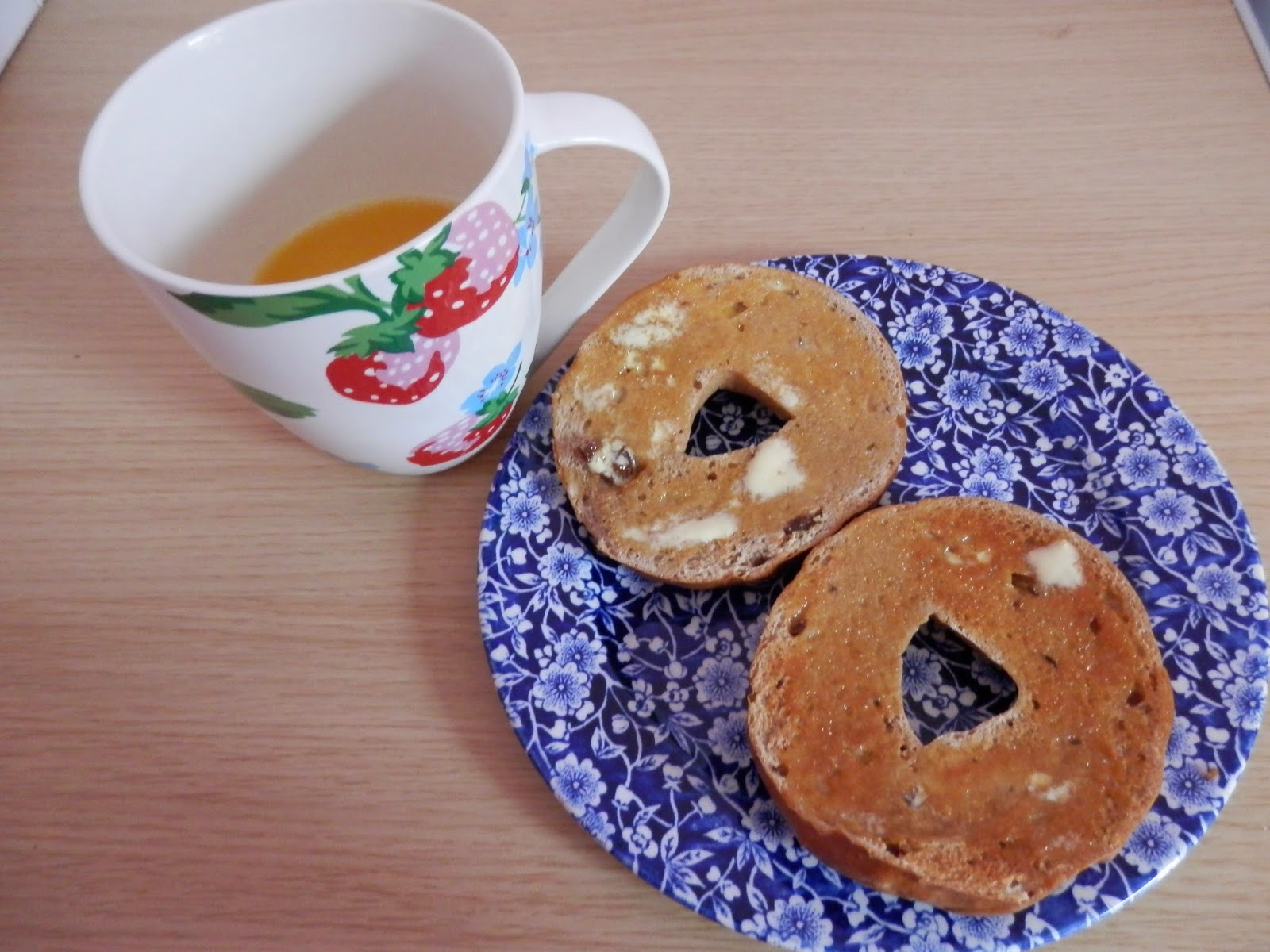 What do vegans eat? Cinnamon raisin bagels, spread with Pure vegan margarine, with OJ for my breakfast.  These bagels are from the brand New York Bakery Co and are really yummy.