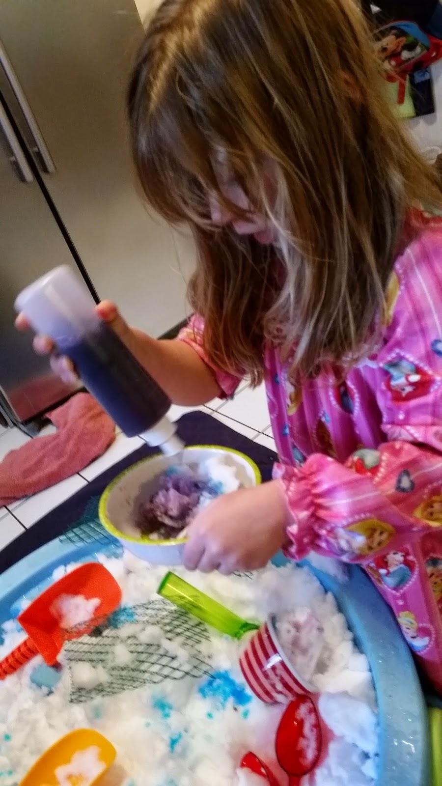 Preschool indoor snow play with color water