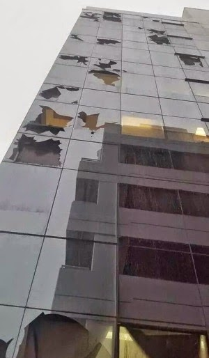 damaged office block building in brisbane CBD after storm