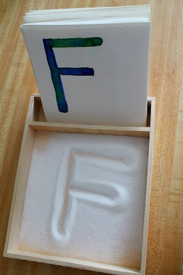 http://thismummaslife.com/2013/02/28/diy-salt-tray-and-alphabet-cards/