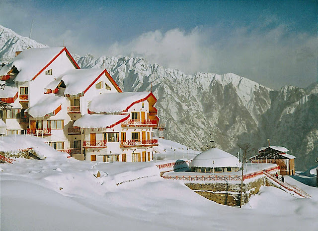 Auli hotels and residence view during ice fall wallpapers
