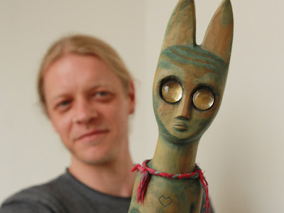 Finnish Animism-inspired Artist Tatu Nikkanen with one of his home gods.