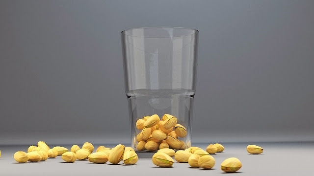 Image of some pistachios in a glass