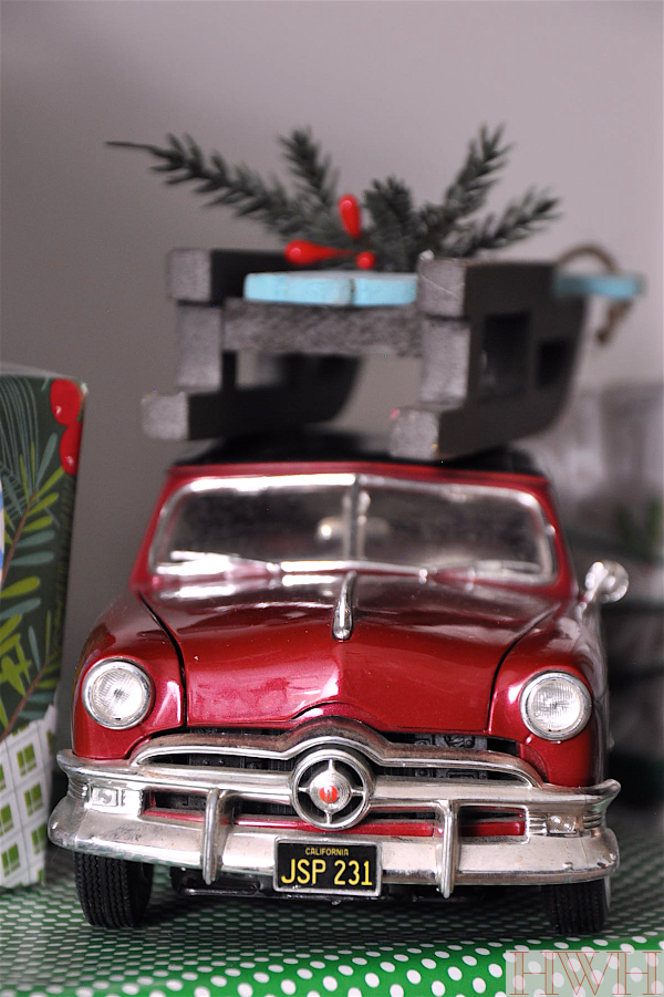 Festive holiday decor using real toys like this red car and sled ornament | Honey We're Home