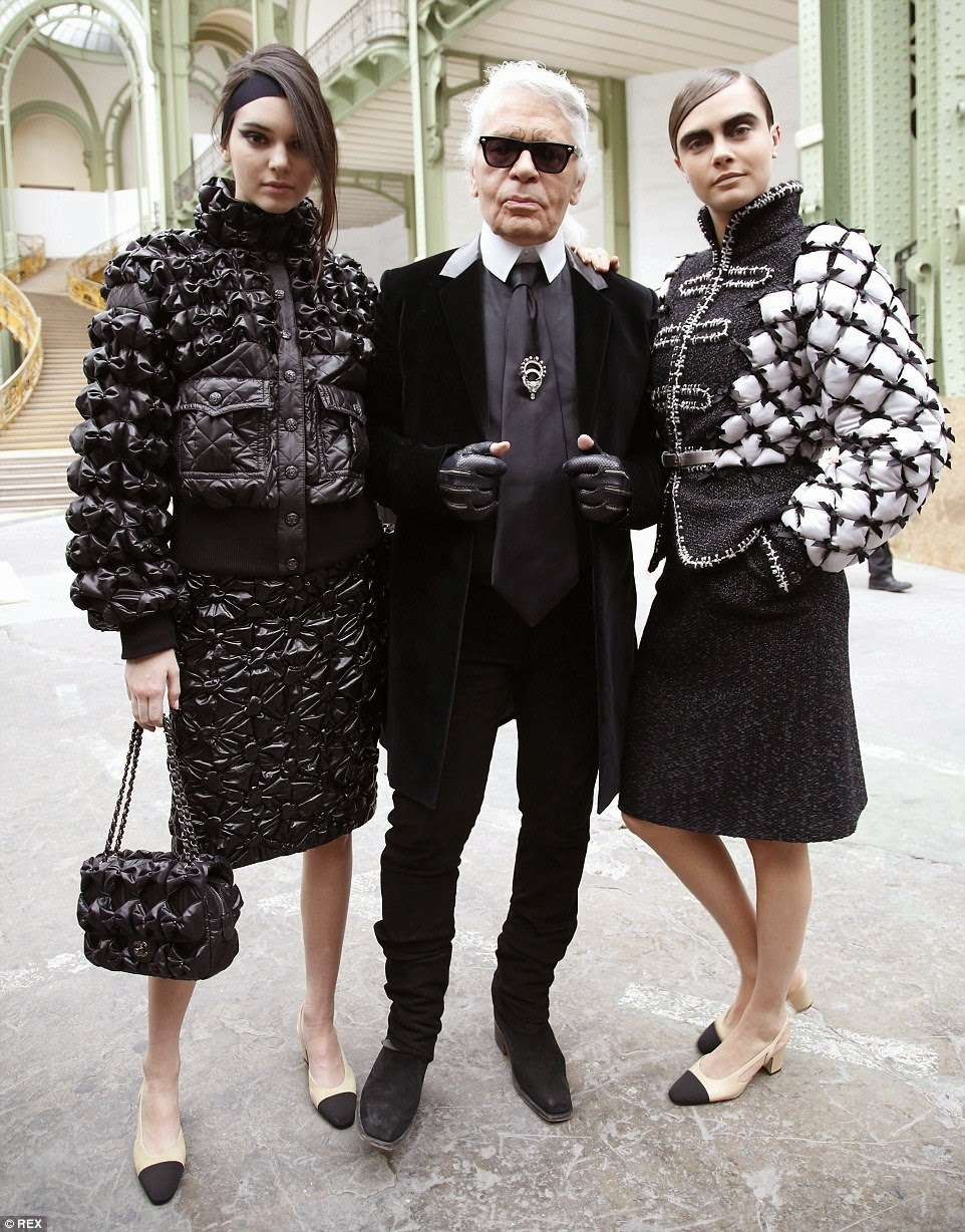 Cara Delevingne and Kendall Jenner walk the Chanel Fall/Winter 2015 Paris Fashion Week Show
