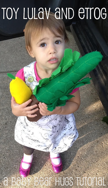 play lulav and etrog made from felt tutorial with baby holding the toy