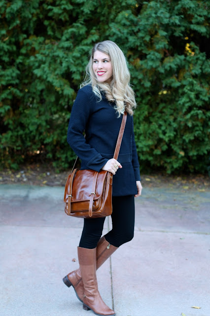 Navy tunic, black leggings, cognac boots, cognac crossbody bag