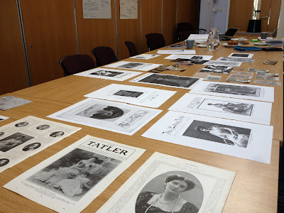 Lots of Mary Curzon images displayed in a meeting room