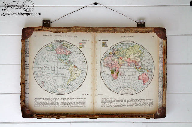 repurposed antique suitcase with world map pages via Knick of Time