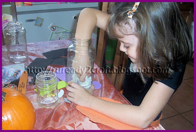 preparing glass jars for a craft