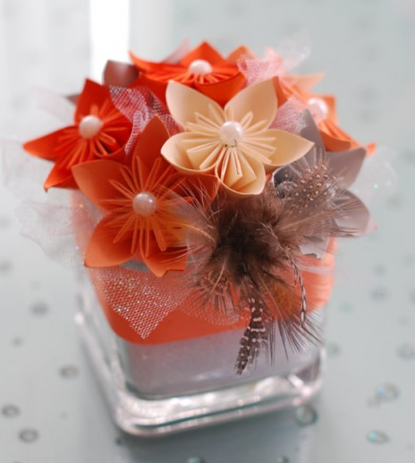 http://www.favcreations.com/product/paper-flower-wedding-centerpiece-orange/