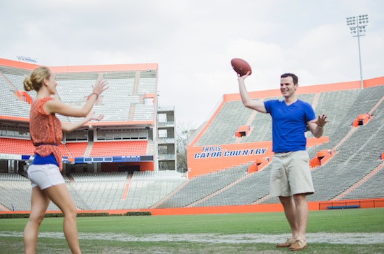 couple throwing around the football during their engagement session