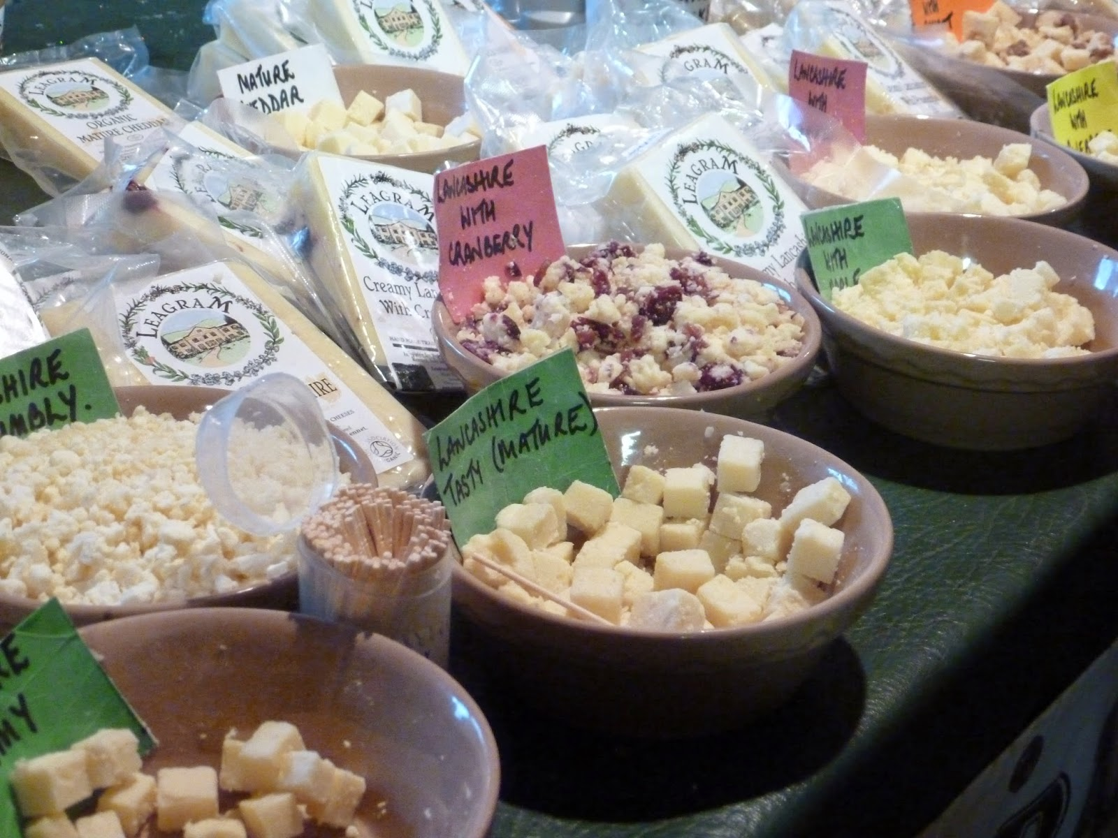 Farmers market stall cheese. Lancashire cheese with cranberry. Crumbly. Mature. Leagram