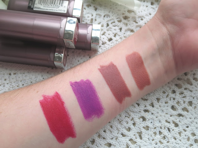 a picture of Maybelline Creamy Matte Lipstick ; Clay Crush, Nude Nuance, Vibrant Violent, Rich Ruby (arm swatch)