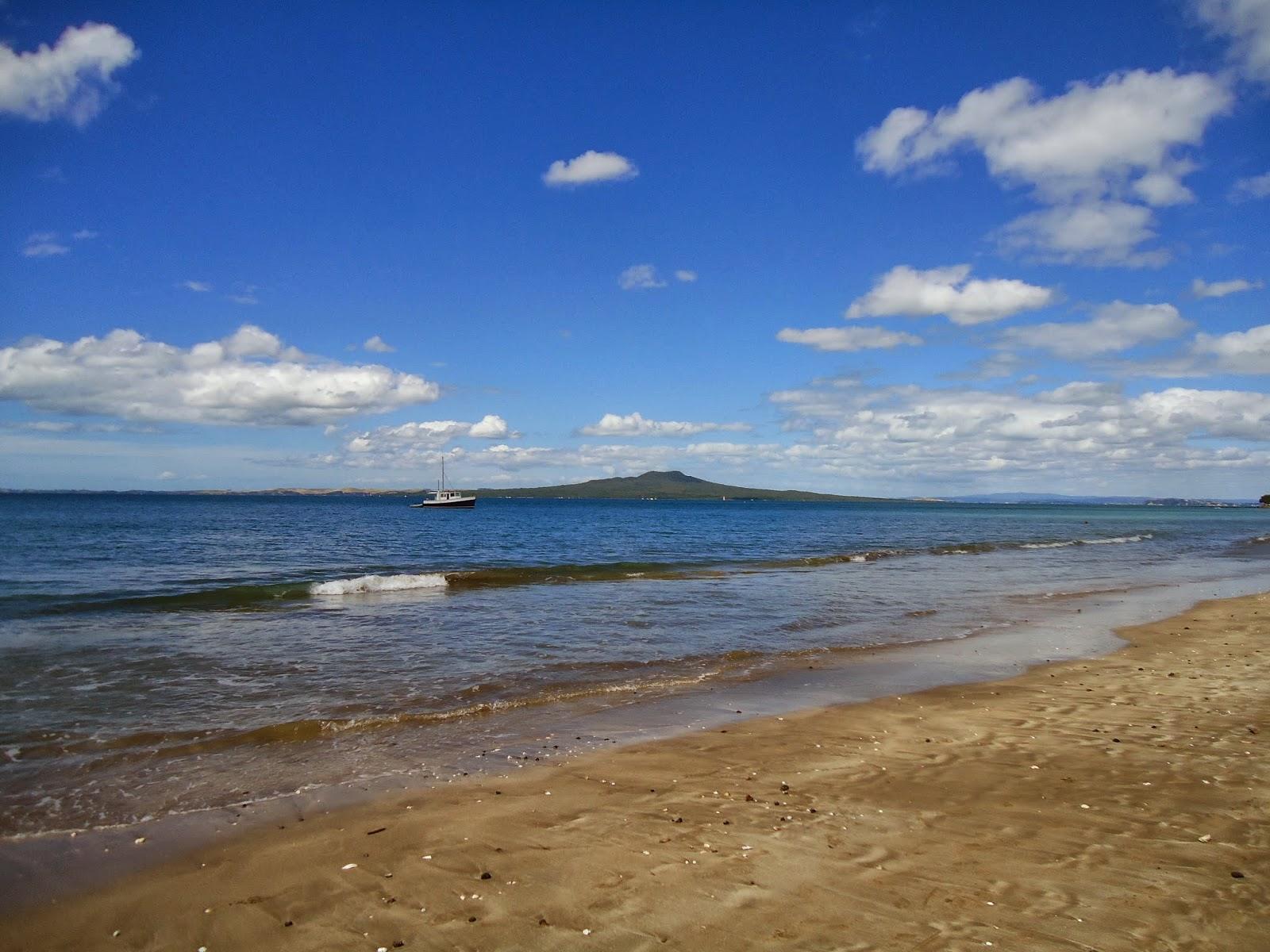Rangitoto island seen from Milford Beach, Auckland, New Zealand