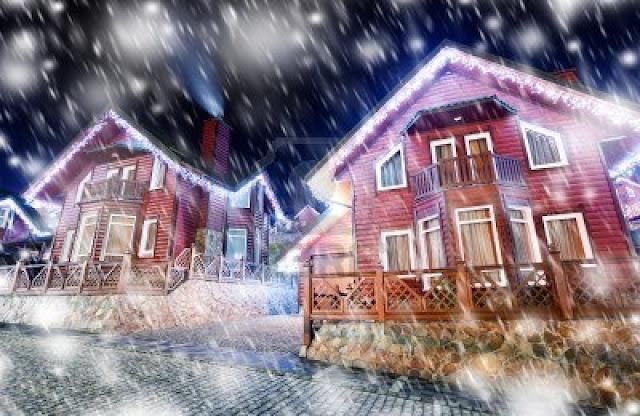 Casas con luces y cayendo nieve