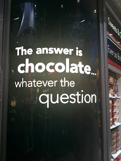 the answer is chocolate... whatever the question - signage at airport duty free shop