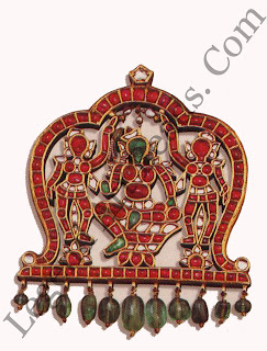 PADAKKAM (pendant) South India 20th century H: 12 cms W: 10.5 cms Private collection USA Set with diamonds, rubies and emeralds each gem has been meticulously carved to form the image of Krishna seated on a lotus flanked by his two consorts Rukmini and Satyabhama.
