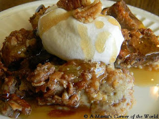 Banana bread pudding shown with butter rum sauce and whipped cream