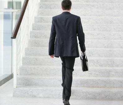 8 Daily Habits to Keep Weight in Check  - business man with a briefcase stairs suit