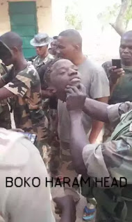 Army cuts off head of Book haram member (Graphic photo)