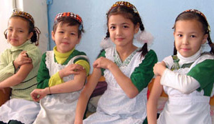 Picture of  cute little girls in white and green dresses, waiting to get immunizations