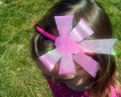 http://www.domesticblisssquared.com/2013/03/diy-sparkly-bow-headbands-066-each.html
