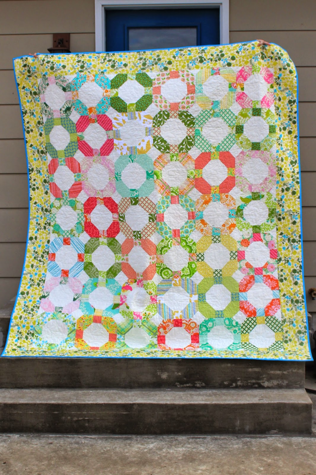 Cheerio quilt made from Heather Bailey's Up Parasol