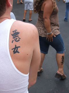 kanji fails: the kanji for 'bad woman' tattooed on a man's shoulder