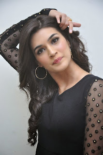 Actress Kriti Sanon Picture Gallery in Black Dress at 1 Nenokkadine Movie Audio Launch Function 0010.jpg