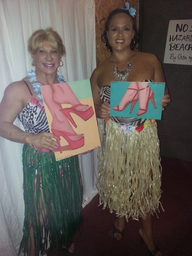 Kat Connors and her friend holding two of the prints (Pretty Feet and Put Yourself in her Shoes) at the Jacksonville Footnight™ Party on Jan 3rd 2015
