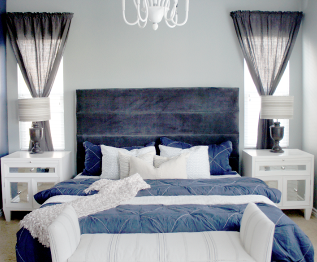gives this bedroom a tranquil and elegant feel while the blue bedding ...