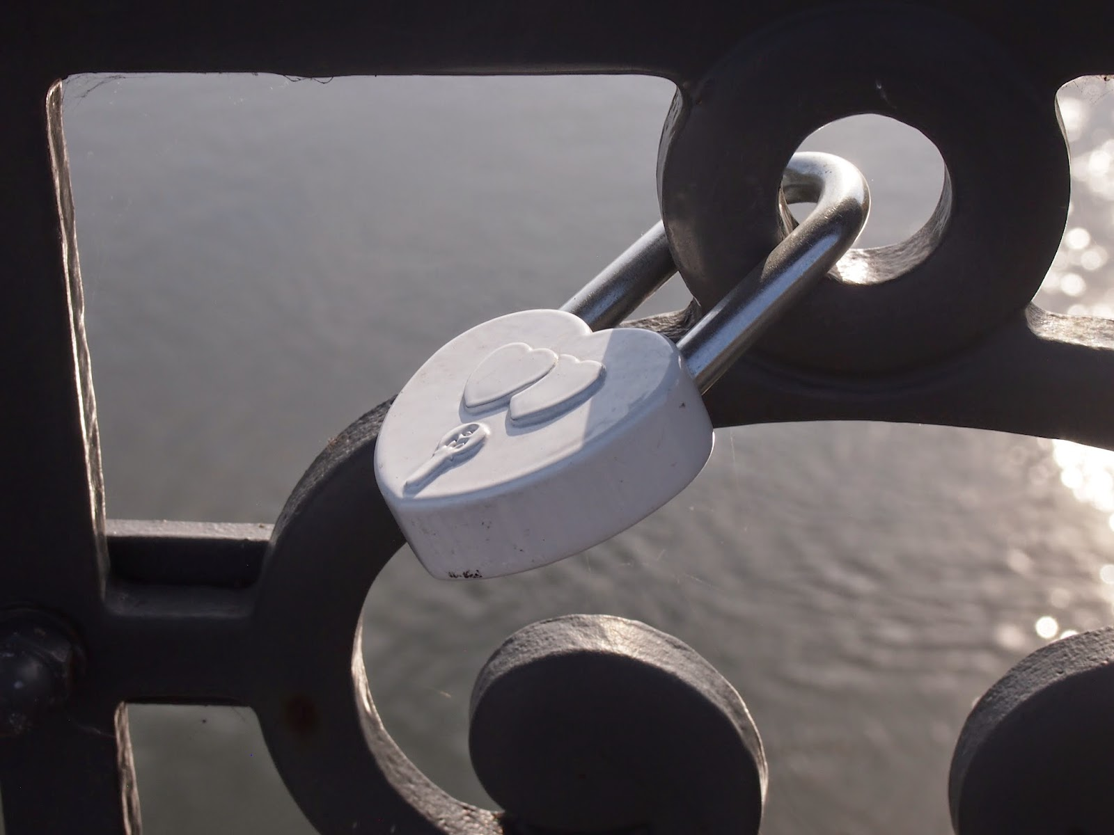 A white love lock over the Neris River