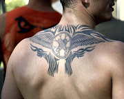 tribal upper back tattoos for men