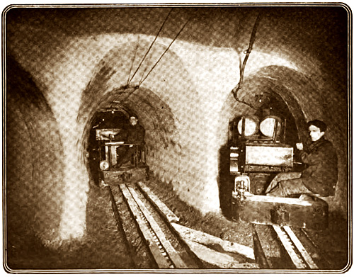 Branch tunnels leaving main shaft.  Superintendent Jackson at lower level of train on the left.