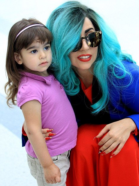 Let's Dance! Lady Gaga wins over a frightened young fan with a twirl at Toronto airport