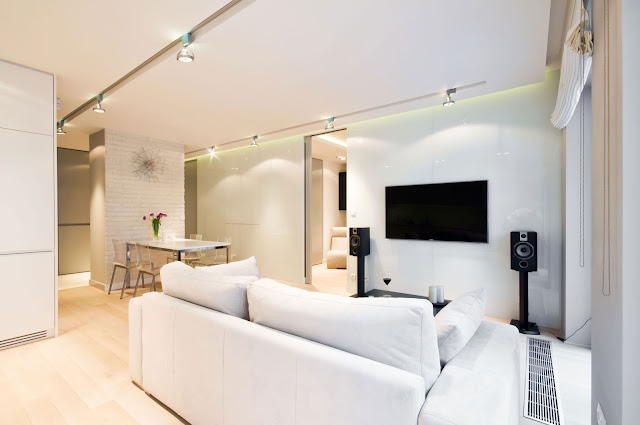 Sofas at Home Lightened by Track Lamp on Ceiling