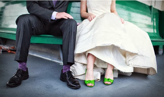 green wedding shoes on brides