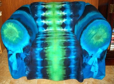 Big chair with blue and green tie-dyed slipcover